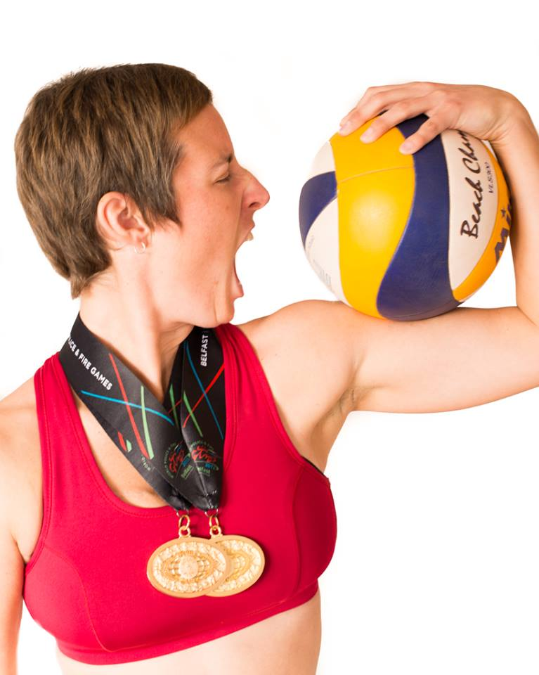 Julie Tremblay: Volleyball Athlete, Detective and Cancer Lifer Julie with Medals