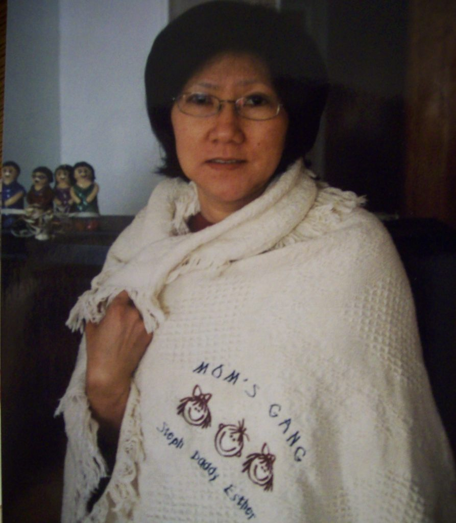 "Esther's mom sporting the ""Mom's Gang"" blanket"