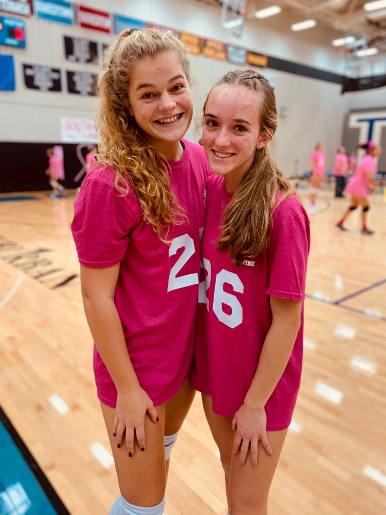 Players pose together at Dig Pink game