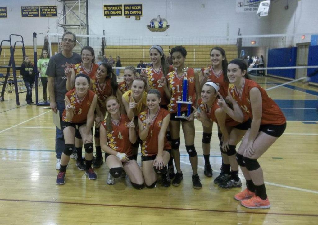 Gabby Huff and her JV volleyball team winning a tournament
