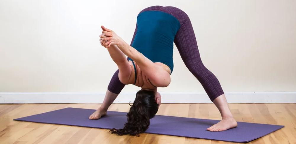 Wide Leg Forward Bend with Shoulder Stretch